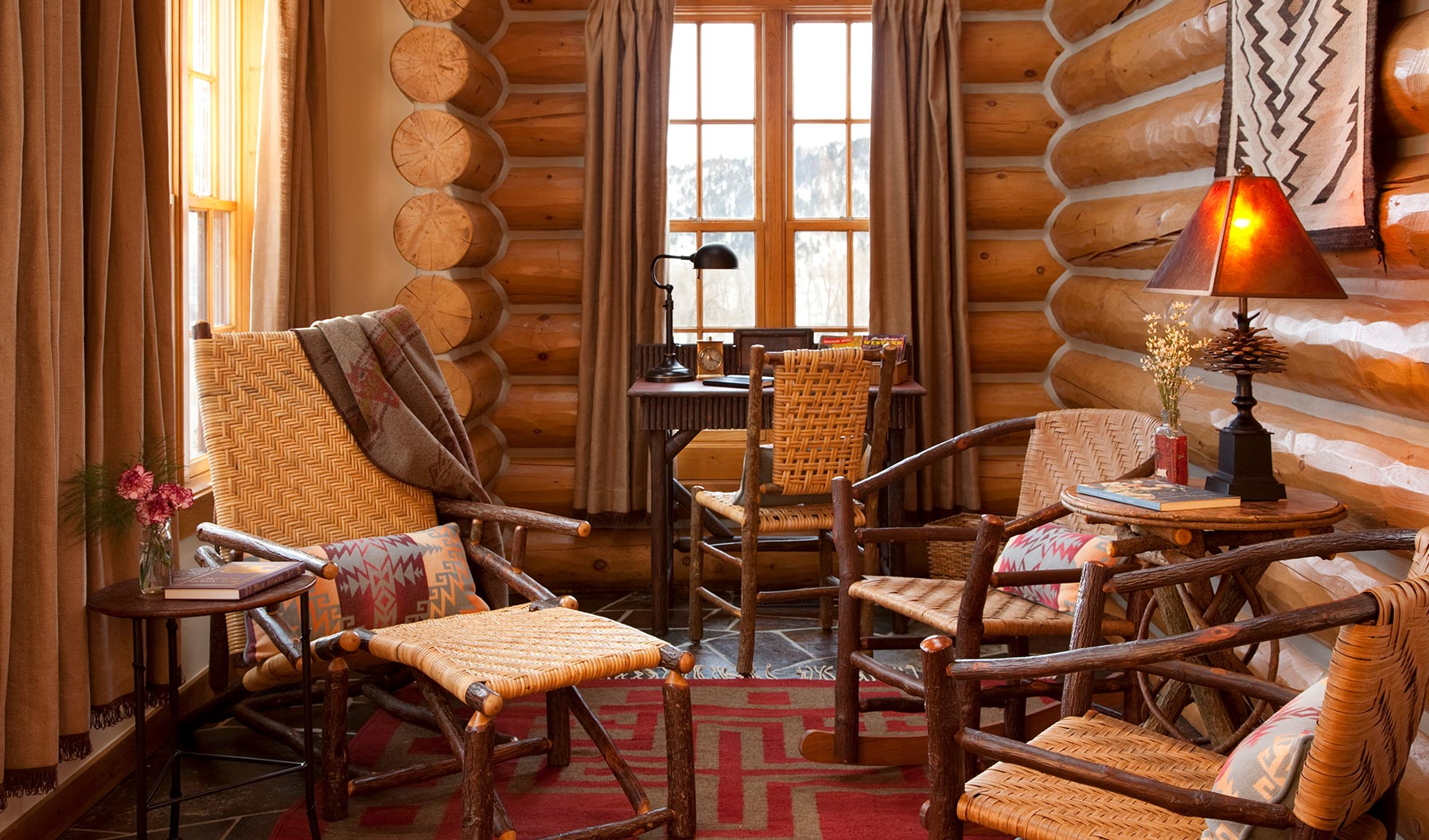 Seating area inside a wooden cabin at The Ranch At Rock Creek